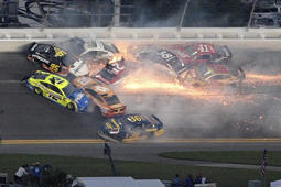 Matt DiBenedetto (95), Ryan Blaney (12), Matt Tifft (36), Aric Almirola (10), Paul Menard (21), Ryan Newman (6), David Ragan (38), Daniel Suarez (41) and Austin Dillon (3) collide between Turns 3 and 4 during the NASCAR Daytona 500 auto race at Daytona International Speedway Sunday, Feb. 17, 2019, in Daytona Beach, Fla. (AP Photo/Phelan M. Ebenhack)