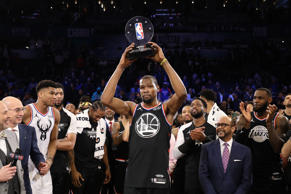 CHARLOTTE, NORTH CAROLINA - FEBRUARY 17:  Kevin Durant #35 of the Golden State Warriors and Team LeBron celebrates with the MVP trophy after their 178-164 win over Team Giannis during the NBA All-Star game as part of the 2019 NBA All-Star Weekend at Spectrum Center on February 17, 2019 in Charlotte, North Carolina. NOTE TO USER: User expressly acknowledges and agrees that, by downloading and/or using this photograph, user is consenting to the terms and conditions of the Getty Images License Agreement. Mandatory Copyright Notice: Copyright 2019 NBAE (Photo by Streeter Lecka/Getty Images)