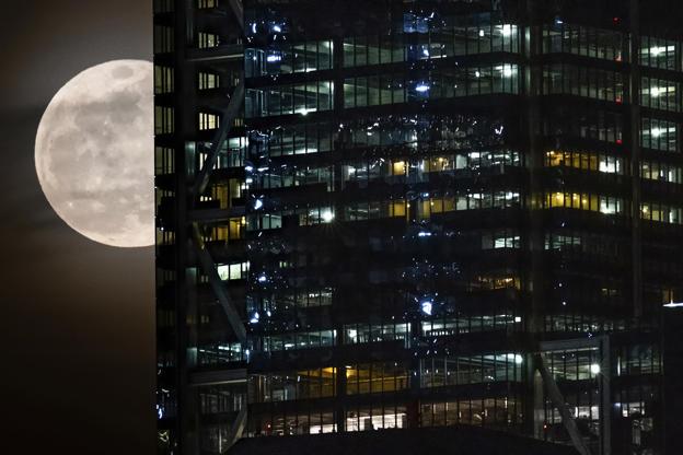 Slide 1 de 31: The full moon passes behind the World Trade Center in New York City, Tuesday, Feb. 19, 2019. (AP Photo/J. David Ake)
