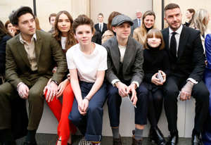 Mandatory Credit: Photo by WWD/Shutterstock (10107639m) Brooklyn Beckham, Hana Cross, Cruz Beckham, Romeo Beckham, Harper Beckham and David Beckham in the front row Victoria Beckham show, Front Row, Fall Winter 2019, London Fashion Week, UK - 17 Feb 2019