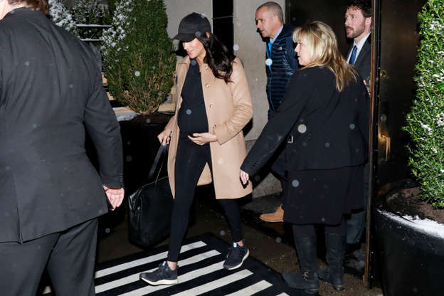 8d8be00566a Meghan Markle Leaves Her Baby Shower in a Camel Coat and Workout Gear