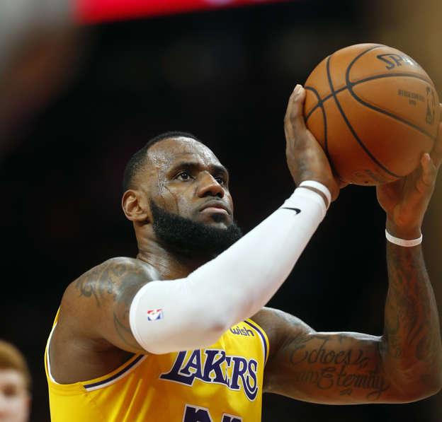 1cbf2b51d70 Los Angeles Lakers forward LeBron James (23) shoots a free throw against  the Atlanta