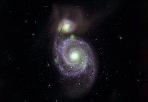 Bright green sources of high-energy X-ray light captured by NASA's NuSTAR mission are overlaid on an optical-light image of the Whirlpool galaxy (the spiral in the center of the image) and its companion galaxy, M51b (the bright greenish-white spot above the Whirlpool), taken by the Sloan Digital Sky Survey. The bright green spots at the center of the Whirlpool and M51b are created by material surrounding supermassive black holes; additional X-ray sources in the vicinity contribute to the emission. The known ultraluminous neutron star is located on the left side of the Whirlpool.