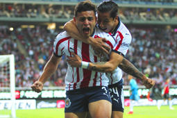 ZAPOPAN, MEXICO - FEBRUARY 16: Ernesto Vega of Chivas celebrates with teammate after scoring the first goal of his team during the seventh round match between Chivas and Atlas as part of the Torneo Clausura 2019 Liga MX at Akron Stadium on February 16, 2019 in Zapopan, Mexico. (Photo by Oscar Meza/Jam Media/Getty Images)