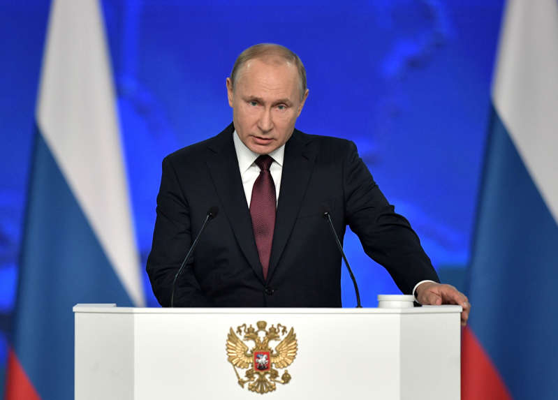 Russian President Vladimir Putin addresses the Federal Assembly, including the State Duma parliamentarians, members of the Federation Council, regional governors and other high-ranking officials, in Moscow.