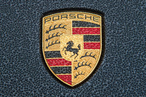 FILE - A file picture dated 03 November 2015 shows the Porsche logo on the rained-on hood of a Porsche Cayenne in Stuttgart, Germany. Photo: Wolfram Kastl/dpa (Photo by Wolfram Kastl/picture alliance via Getty Images)