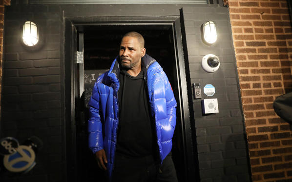 R. Kelly emerges from his Chicago studio on Friday, Feb. 22, 2019.