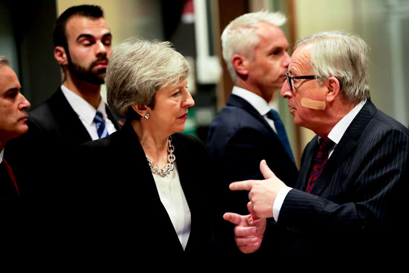 European Commission President Jean-Claude Juncker, right, speaks with British Prime Minister Theresa May prior to a meeting at EU headquarters in Brussels, Wednesday, Feb. 20, 2019. European Commission President Jean-Claude Juncker and British Prime Minister Theresa May meet Wednesday for their latest negotiating session to seek an elusive breakthrough in Brexit negotiations. (AP Photo/Olivier Matthys)