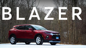 a car parked in front of a sign: 2019 Chevrolet Blazer Quick Drive