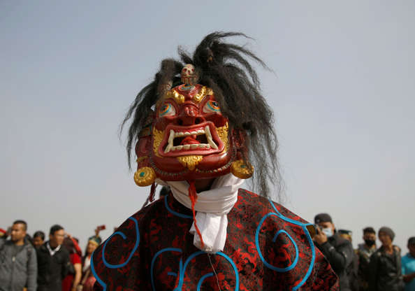 Slide 2 of 129  A masked dancer in traditional attire performs during the  Sonam Lhosar a288282a3