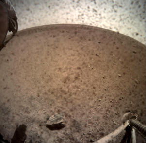 An image acquired by NASA's InSight Mars lander shows the area in front of the lander using its lander-mounted, Instrument Context Camera (ICC) on Mars November 30, 2018. Image acquired November 30, 2018.  NASA/JPL-Caltech/Handout via REUTERS.  ATTENTION EDITORS - THIS IMAGE WAS PROVIDED BY A THIRD PARTY