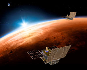 FILE - This illustration made available by NASA on March 29, 2018 shows the twin Mars Cube One (MarCO) spacecraft flying over Mars with Earth and the sun in the distance. As of Wednesday, Feb. 6, 2019, NASA hasn't heard from the briefcase-size spacecraft for more than a month - and doubts it ever will. The twin satellites shadowed NASA's InSight lander to Mars in 2018. (NASA/JPL-Caltech via AP)
