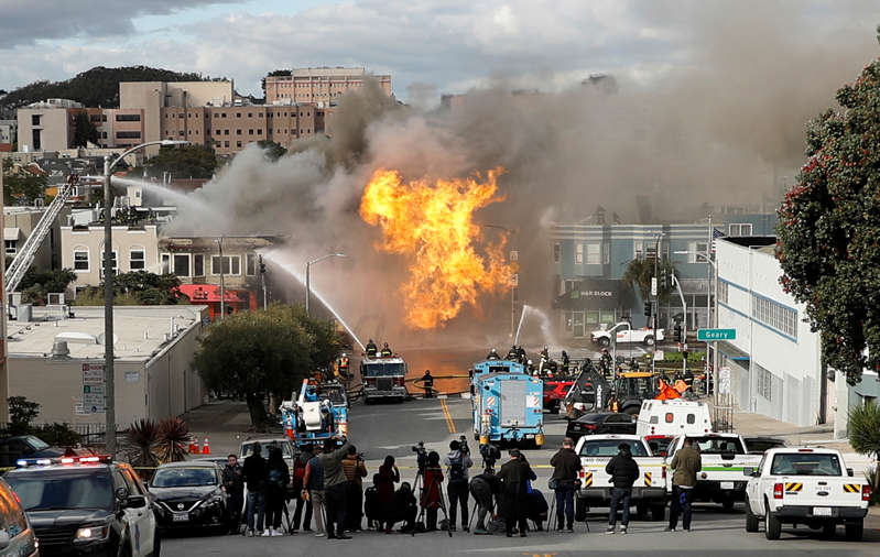 Fire fighters battle a fire sparked by a ruptured gas line in San Francisco, California, U.S., February 6, 2019. REUTERS/Stephen Lam