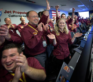 Bruce Banerdt (C), InSight Principal Investigator, NASA JPL, Hallie Gengl, Data Visualization Developer, NASA JPL, (R), and other NASA InSight team members celebrate after the first image of Mars from the Mars InSight lander are shown at NASA's Jet Propulsion Laboratory in Pasadena, California, U.S., November 26, 2018     NASA/Bill Ingalls/Handout via REUTERS     ATTENTION EDITORS - THIS IMAGE WAS PROVIDED BY A THIRD PARTY.