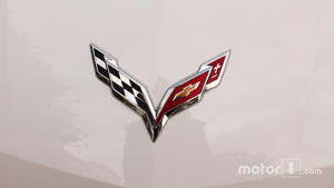 a close up of text on a white background: Corvette logo
