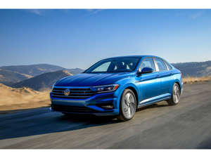 a blue car parked on the side of a road: 2019 Volkswagen Jetta