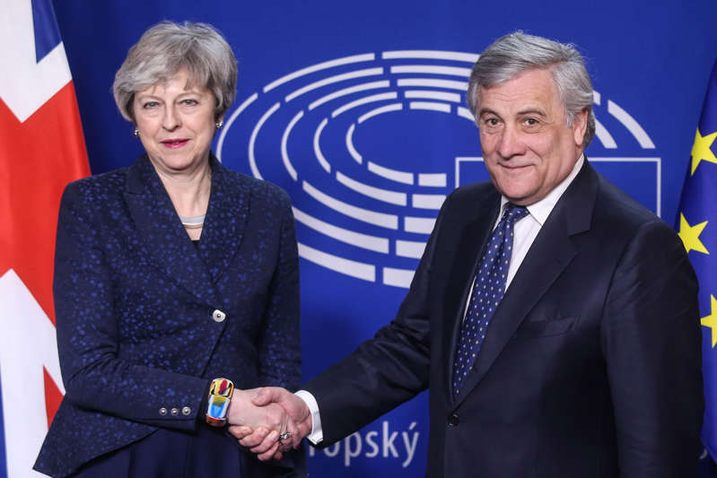 European Parliament President Antonio Tajani shakes hand with British Prime Minister Theresa May before a meeting at the European Parliament on February 7, 2019 in Brussels, after she agreed earlier with European Union president to hold further talks on Britain's withdrawal from the bloc, after what they described as a 'robust' meeting. (Photo by François WALSCHAERTS / AFP)        (Photo credit should read FRANCOIS WALSCHAERTS/AFP/Getty Images)