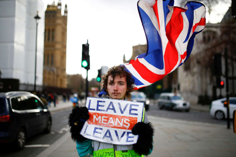 A pro-Brexit protester stands outside the Houses of Parliament in London, Britain, February 7, 2019. REUTERS/Henry Nicholls