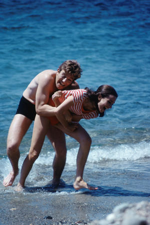 Actor Albert Finney and Audrey Hepburn frolicking on the beach in Stanley Donen's 1967 film Two For The Road.