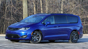 a blue car parked on the side of a road: 2019 Chrysler Pacifica Hybrid Review