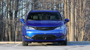 a truck is parked in front of a blue car: 2019 Chrysler Pacifica Hybrid Review