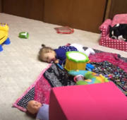 This baby just made up her own strange but adorable game