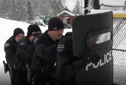 See kids take down cops in hilarious snowball fight
