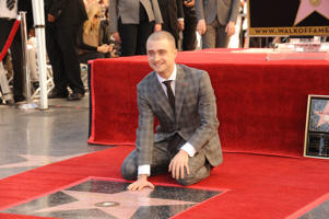 Actor Daniel Radcliffe posing at the ceremony that honored him with a Star on the Hollywood Walk of Fame. (Photo by Frank Trapper/Corbis via Getty Images)