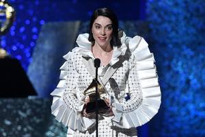 "St. Vincent accepts the award for Best Rock Song with ""Masseduction"" during the 61st Annual Grammy Awards pre-telecast show on February 10, 2019, in Los Angeles. (Photo by Robyn Beck / AFP)        (Photo credit should read ROBYN BECK/AFP/Getty Images)"