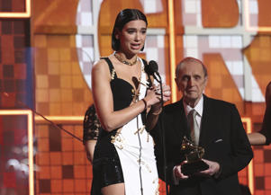 Dua Lipa accepts the award for best new artist at the 61st annual Grammy Awards on Sunday, Feb. 10, 2019, in Los Angeles. Looking on at right is presenter Bob Newhart. (Photo by Matt Sayles/Invision/AP)