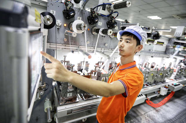 YANCHENG, CHINA - JULY 21: An employee works at a manufacturing company on July 21, 2018 in Yancheng, Jiangsu Province of China. China's producer price index (PPI) rose 4.6 percent in July year-on-year, according to the National Bureau of Statistics (NBS) on Thursday. (Photo by Ying Bo/China News Service/VCG)
