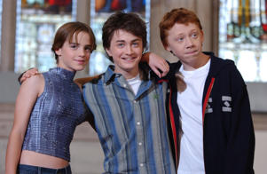 Stars from the latest Harry Potter film 'Harry Potter and the Chamber of Secrets' (from left) Emma Watson, Daniel Radcliffe and Rupert Grint, during a photocall at the Guildhall, London, to promote the new film.   (Photo by Andy Butterton - PA Images/PA Images via Getty Images)