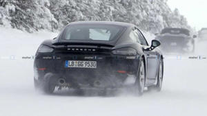 a car covered in snow: Porsche 718 Cayman GT4 Touring Spy Shots