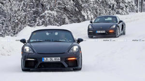a police car parked on the side of a snow covered road: Porsche 718 Cayman GT4 Touring Spy Shots