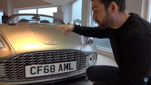 a man standing in front of a car: Aston Martin Vanquish Zagato grille lead image
