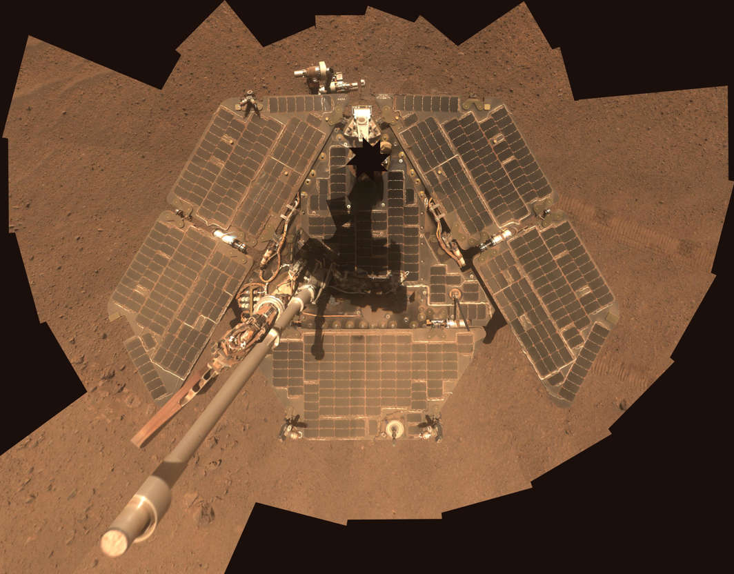 Slide 1 of 16: A self-portrait of NASA's Mars Exploration Rover Opportunity taken by the rover's panoramic camera (Pancam) in late March 2014 shows effects of recent winds removing much of the dust from the rover's solar arrays.