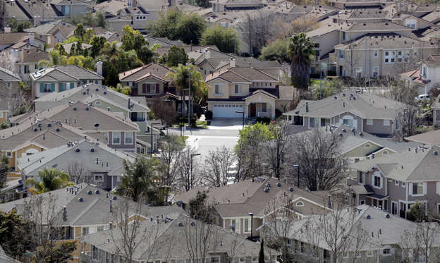 In this Tuesday, March 6, 2018, photo homes stack up in a neighborhood in San Jose, Calif. NerdWallet calculated affordability for 173 metropolitan areas by comparing the median annual household income and the monthly principal-and-interest payment for a median-priced single-family home and found that the least affordable homes are in the San Jose. (AP Photo/Marcio Jose Sanchez)