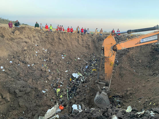 An excavator works at the crash site of an Ethiopian Airlines' aircraft, some 50 km east of Addis Ababa, capital of Ethiopia, on March 10, 2019. All 157 people aboard Ethiopian Airlines flight were confirmed dead as Africa's fastest growing airline witnessed the worst-ever incident in its history. The incident on Sunday, which involved a Boeing 737-800 MAX, occurred a few minutes after the aircraft took off from Addis Ababa Bole International Airport to Nairobi, Kenya. It crashed around Bishoftu town, the airline said.