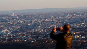 A tourists enjoys a sunny day on mount Kahlenberg in Vienna, Austria March 12, 2019. Picture taken March 12, 2019. REUTERS/Leonhard Foeger