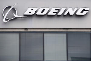 The Boeing Company logo is seen on a building in Annapolis Junction, Maryland, on March 11, 2019. - Tumbling shares in US aviation giant Boeing on Monday tore a hole in the Dow Jones Industrial Average, sending the benchmark index into the red for a sixth day.About five minutes into the day's trading, Boeing shares were down 11.7 percent at $373.23 following the most recent crash of one of its aircraft in Ethiopia.The Dow fell 153.81 points to 25,319.42, but the broader S&P 500 rose 0.3 percent to 2,758.27 and the tech-heavy Nasdaq was up an even stronger 0.7 percent at 7,474.61.The fatal crash of the Ethiopian Airlines Flight ET302 -- the second involving a Boeing 737 Max 8 in five months -- caused airlines in three countries to ground all flights involving the popular jet and cast fresh safety concerns on the airline. (Photo by Jim WATSON / AFP)        (Photo credit should read JIM WATSON/AFP/Getty Images)