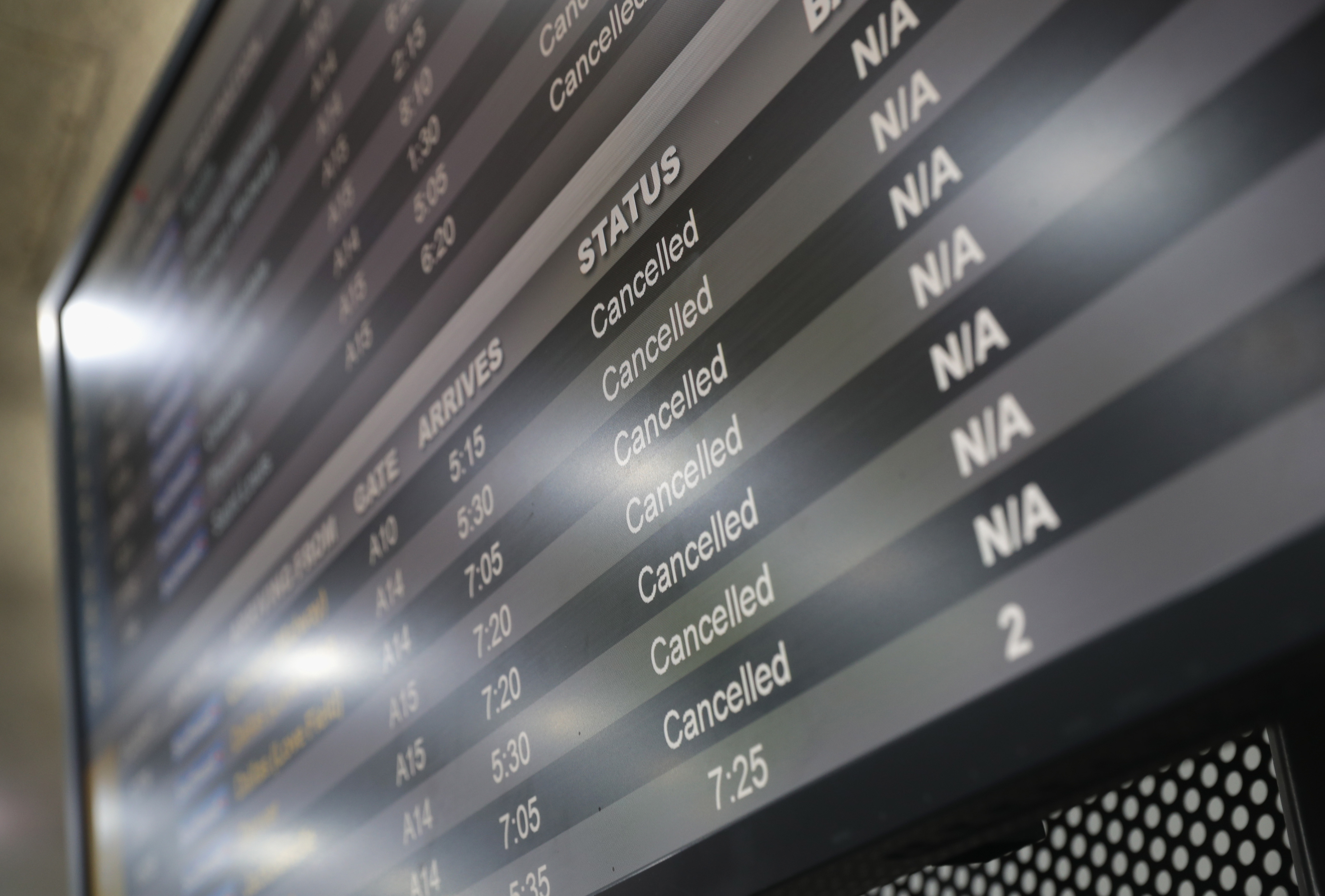 NEWARK, NJ - NOVEMBER 15:  A board shows cancelled flights due to a snow storm at the Newark Liberty International Airport on November 15, 2018 in Newark, New Jersey. The early season storm caused flight cancellations in much of the northeast.  (Photo by John Moore/Getty Images)