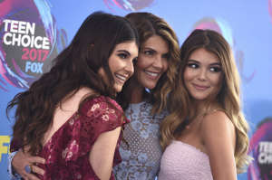 Bella Loughlin, from left. Lori Loughlin, and Olivia Loughlin arrive at the Teen Choice Awards at the Galen Center on Sunday, Aug. 13, 2017, in Los Angeles. (Photo by Jordan Strauss/Invision/AP)