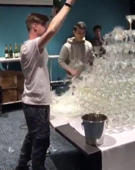 Bartender's beautiful champagne tower takes a tumble