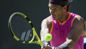 Rafael Nadal, of Spain, returns a shot to Filip Krajinovic, of Serbia, at the BNP Paribas Open tennis tournament Wednesday, March 13, 2019, in Indian Wells, Calif. (AP Photo/Mark J. Terrill)