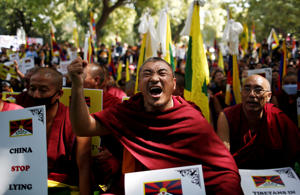 Tibetans shout slogans during a protest held to mark the 60th anniversary of the Tibetan uprising against Chinese rule, in New Delhi, India, March 10, 2019. REUTERS/Adnan Abidi TPX IMAGES OF THE DAY