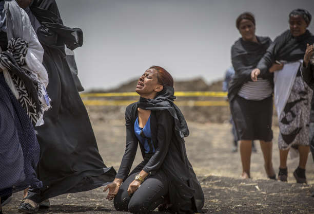 f7cd86530 Slide 4 of 48: Ethiopian relatives of crash victims mourn and grieve at the  scene
