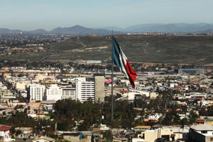 TIJUANA, MEXICO - JANUARY 19 The hills of California stand beyond the Mexican border city of Tijuana on January 19, 2019 in Tijuana, Mexico. Tijuana has experienced a surge in Central Americans seeking to cross the border into America.