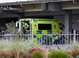 An ambulance carries wounded people to the hospital after gunmen attacked the two mosques.