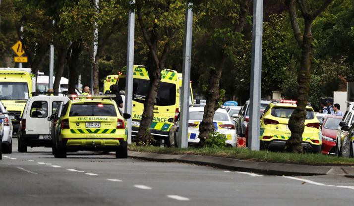 Slide 1 of 7: Ambulances parked outside a mosque in central Christchurch, New Zealand, Friday, March 15, 2019. Many people were killed in a mass shooting at a mosque in the New Zealand city of Christchurch on Friday, a witness said. Police have not yet described the scale of the shooting but urged people in central Christchurch to stay indoors. (AP Photo/Mark Baker)
