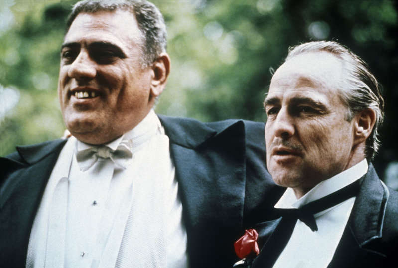 USA - American actors Marlon Brando and Lenny Montana on the set of mob-drama film The Godfather (Le Parrain), based on the novel of the same name by Mario Puzo and directed by Francis Ford Coppola, 1972. (Photo by STILLS/Gamma-Rapho via Getty Images)